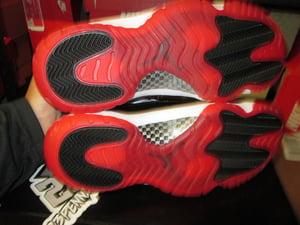 "Image of Air Jordan XI (11) Retro Low ""Blk/White/University Red"""
