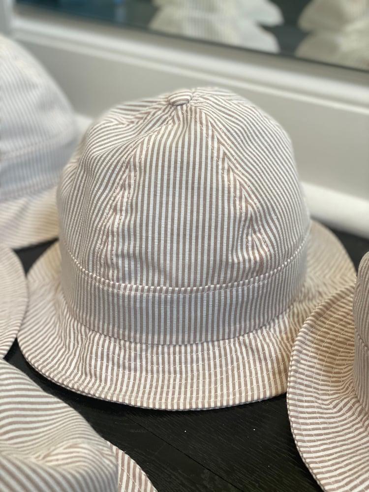 Image of White and tan seersucker bucket