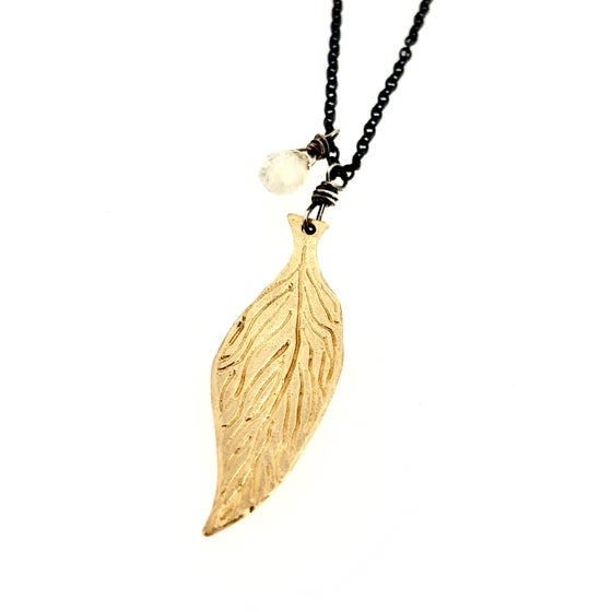 Image of Reserved . 14k gold feather necklace with white sapphire