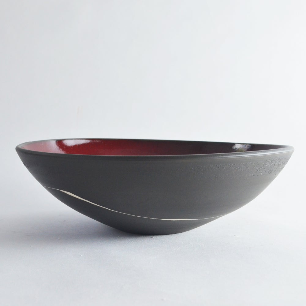 Image of black and red serving bowl