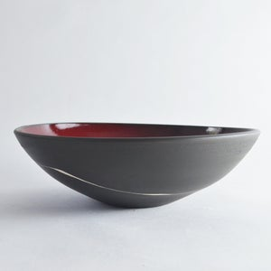 Image of Black and red large serving bowl