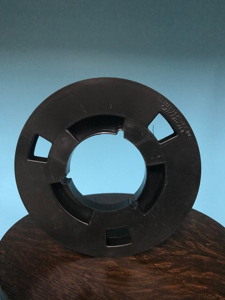 "Image of 1/2"" X 7"" NAB Open Center Plastic  Reel  Black RTM RMG ATR"