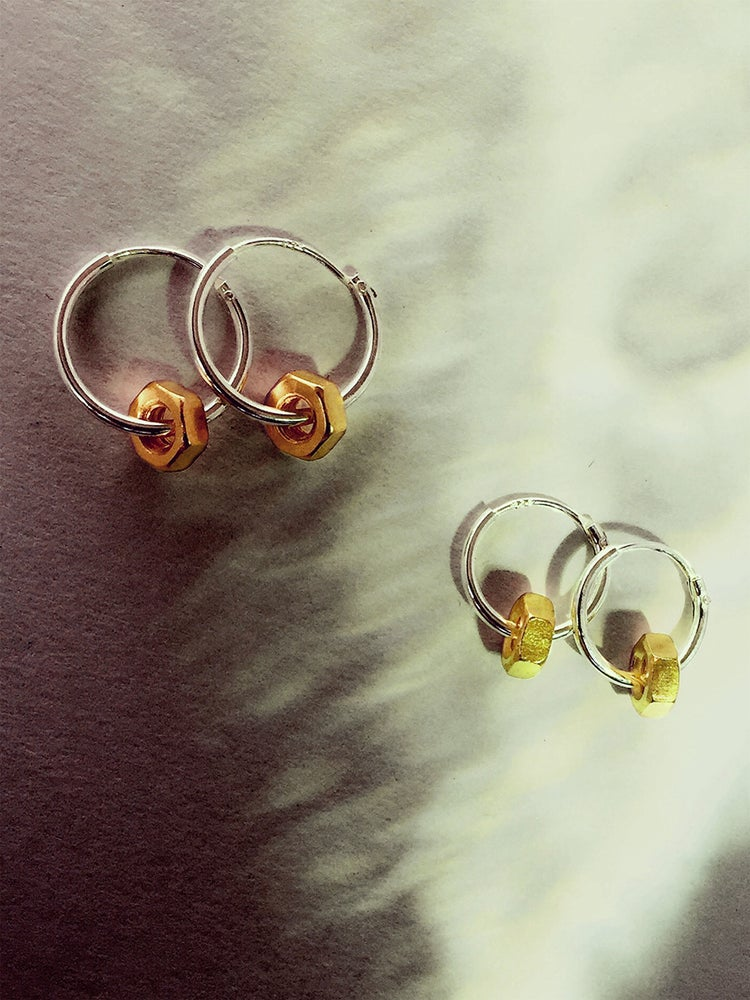 THE LIGHT IS BEAUTIFULLY REFLECTED THE BY THE SURFACES OF THE NUT   High quality 925 silver thin and delicate hoop earring adorned with gold plated nut  Hoops are available in 11, 13 and 15mm diameter, inform us when placing an order  Put on and never take off!  To wear as a single in a 2nd or 3rd piercing, but we also love the cleanness of them as a matching pair.  Possible to buy a single piece to mix and match