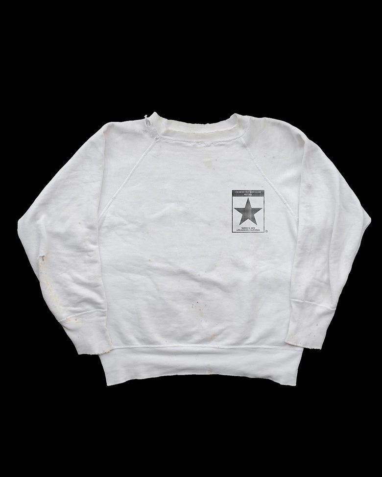 "Image of ""I'VE NEVER FELT SO ALONE"" RAGLAN CREWNECK"