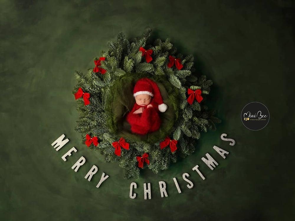 Image of Christmas footed pyjama. Preorder