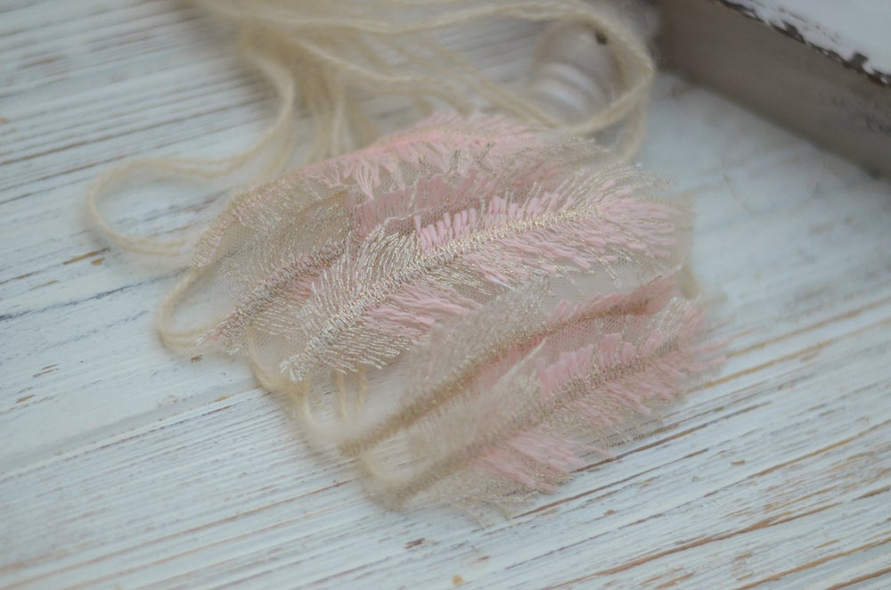 Image of Embroidery feather tieback