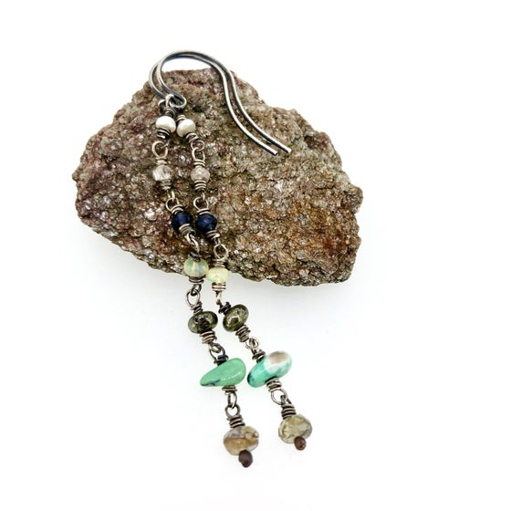 Image of pearl, iolite, opal, variscite, and sapphire earrings