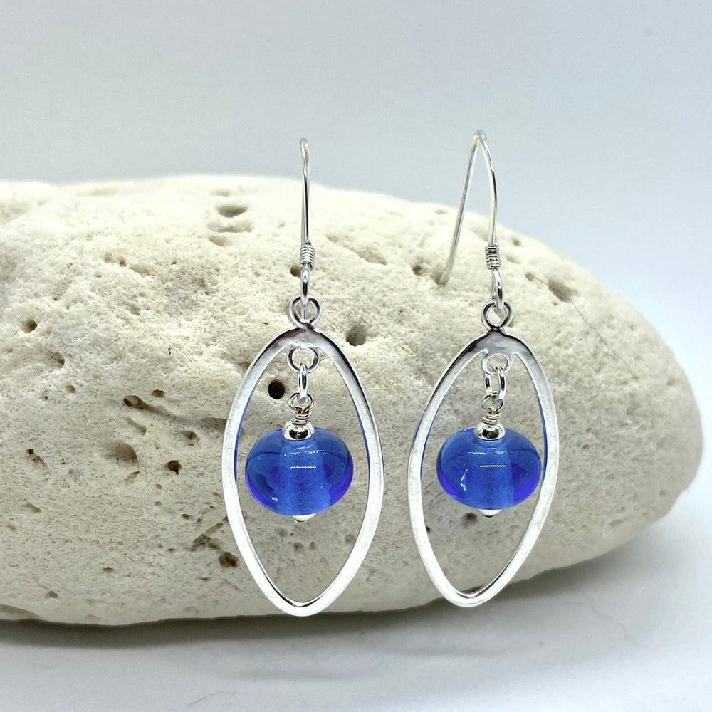 Image of Transparent Medium Blue Oval Earrings