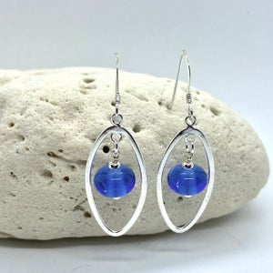 Image of Clear Blue Oval Earrings