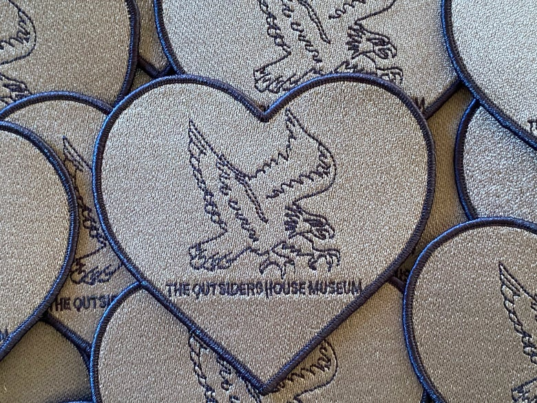 "Image of The Outsiders House Museum ""Steve Randle Eagle Tattoo"" Heart Patch."