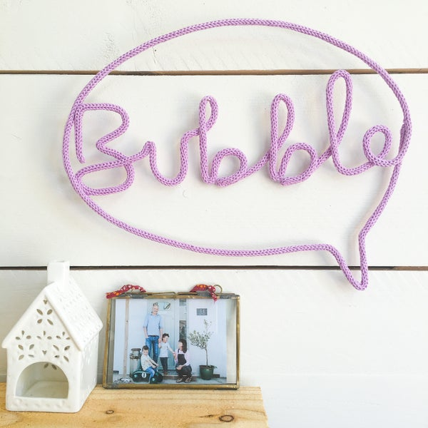 Image of Bubble knitted wire word