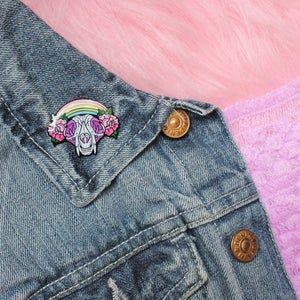 Image of Cat Skull with rainbow & roses enamel pin - creepy cute - pastel goth - spooky - lapel pin badge
