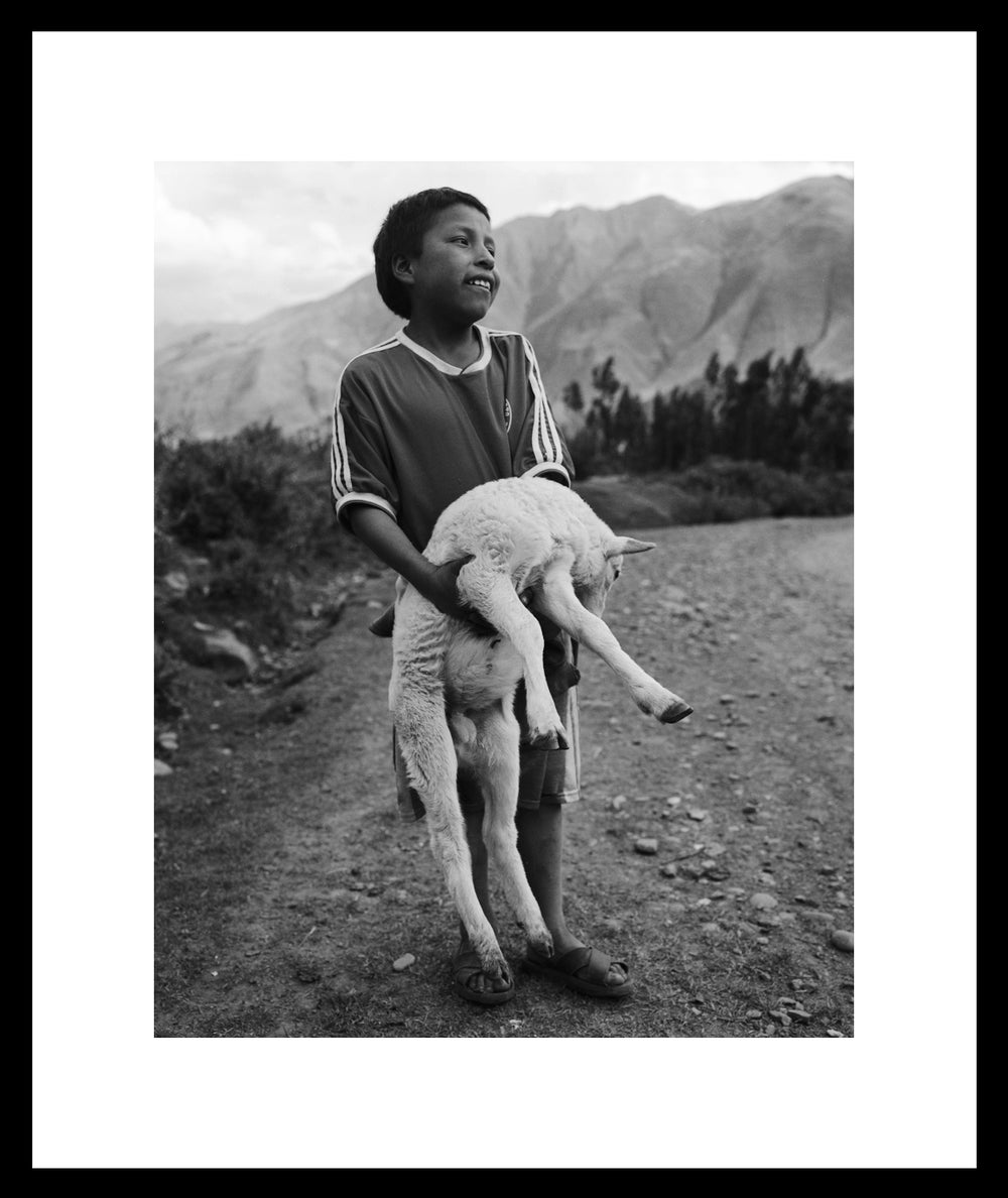 Image of Boy and his lamb. Sacred Valley, Peru.  2006