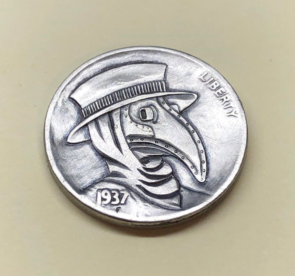 Image of Plague doctor buffalo nickel carved coin