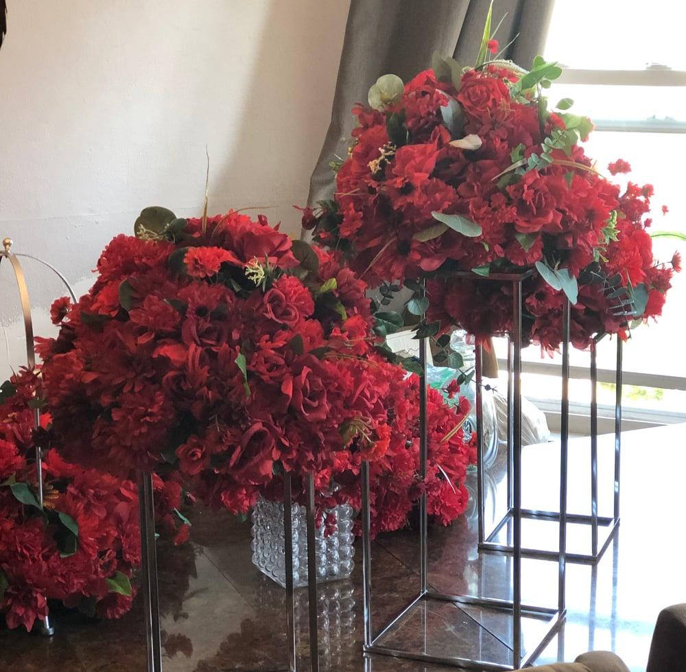 Various floral centerpieces and arrangements