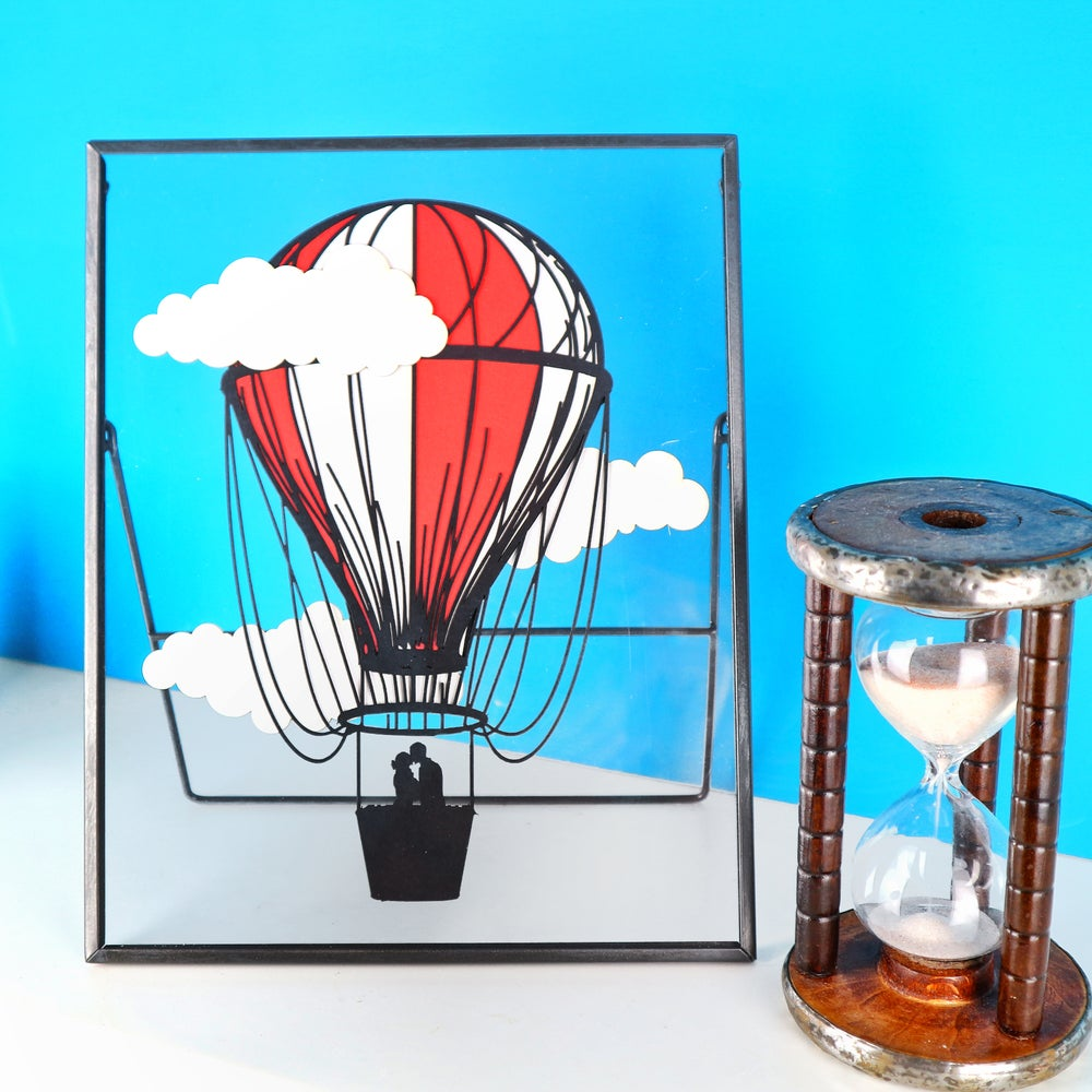 Image of Hot Air Balloon & Clouds in Clear Frame