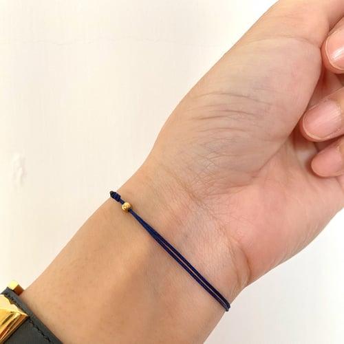 Image of BOX AND CROSS Triple pearl bracelet