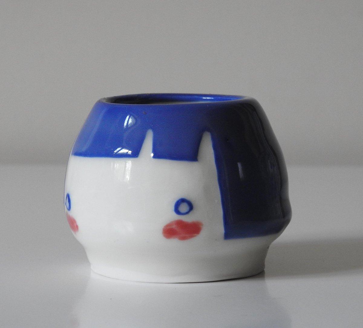 Image of little face bud vase