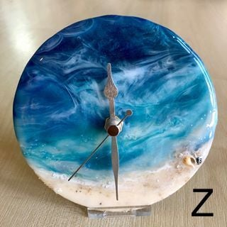 Image of 'Sea D' shelf clocks with stand.