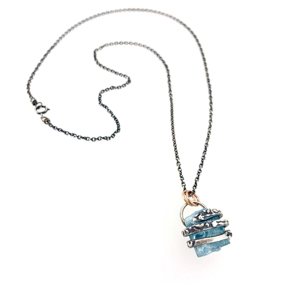 Image of raw aquamarine necklace with coil setting