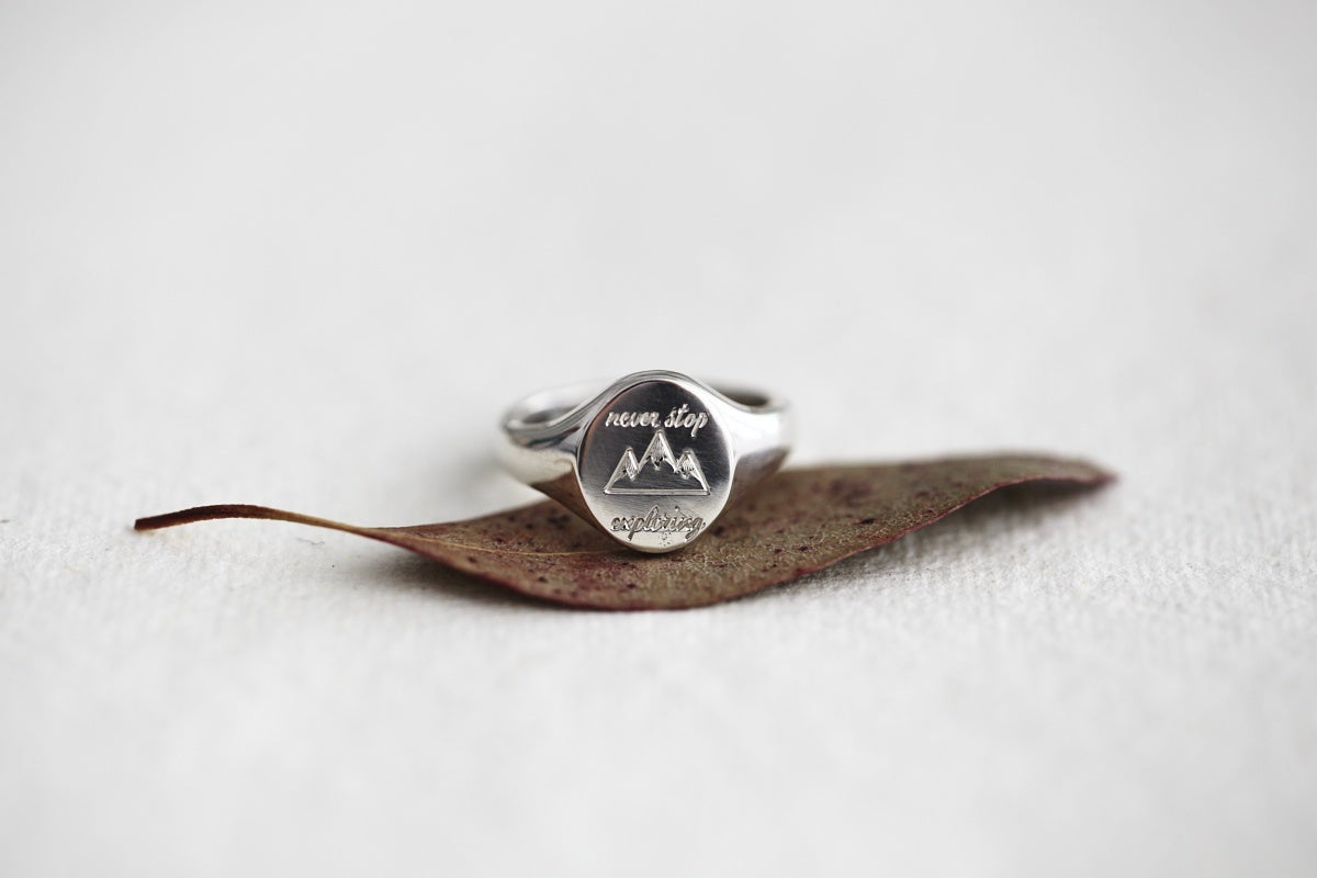 Image of 'Never stop exploring' hand engraved signet ring (metal options available)