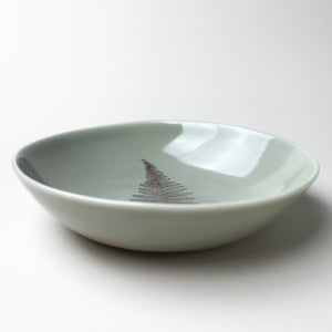 Image of pasta bowl with fern, sage