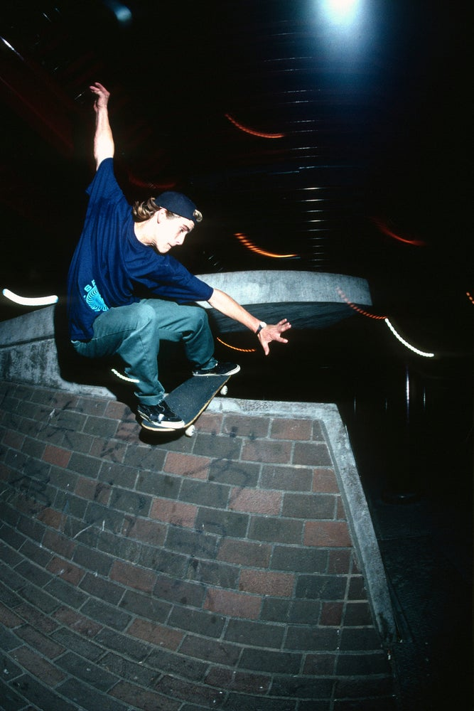 John Cardiel, fakie lipslide China Banks, San Francisco 1991 by Tobin Yelland