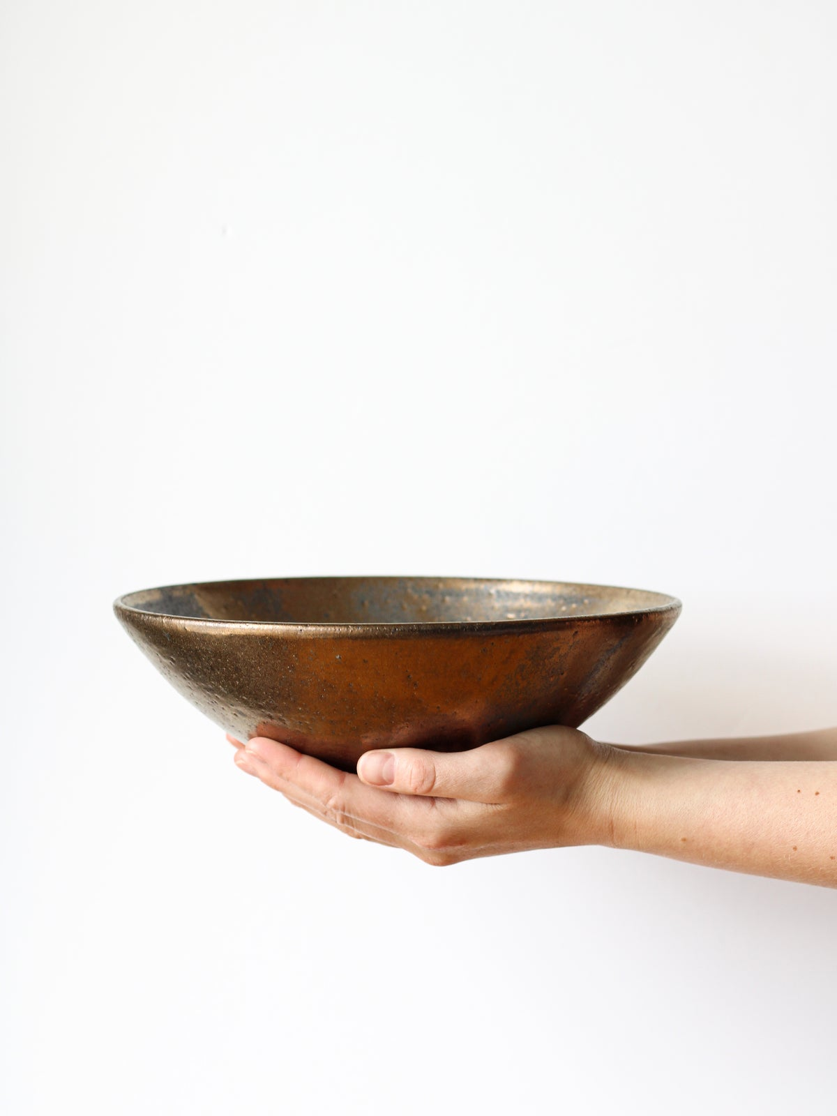Image of shallow bowl in gold glaze