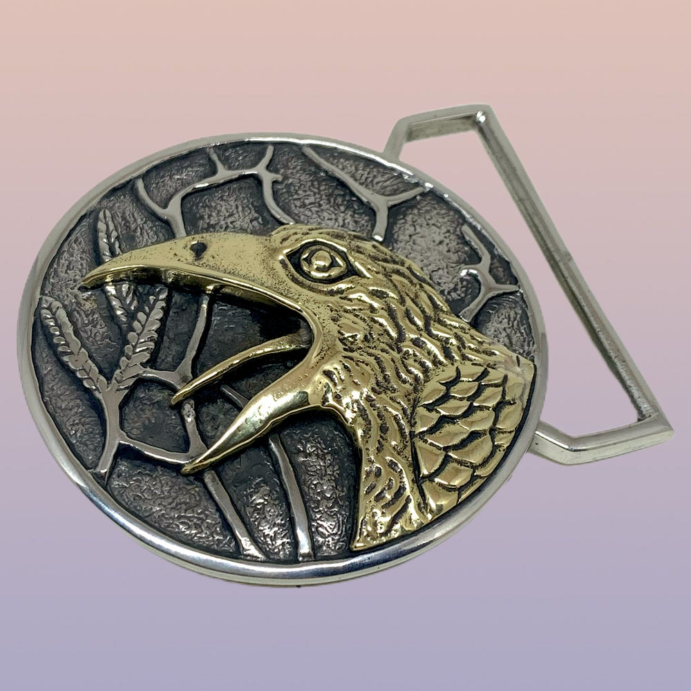 Image of The Raven Buckle Cast in White and Yellow Brass