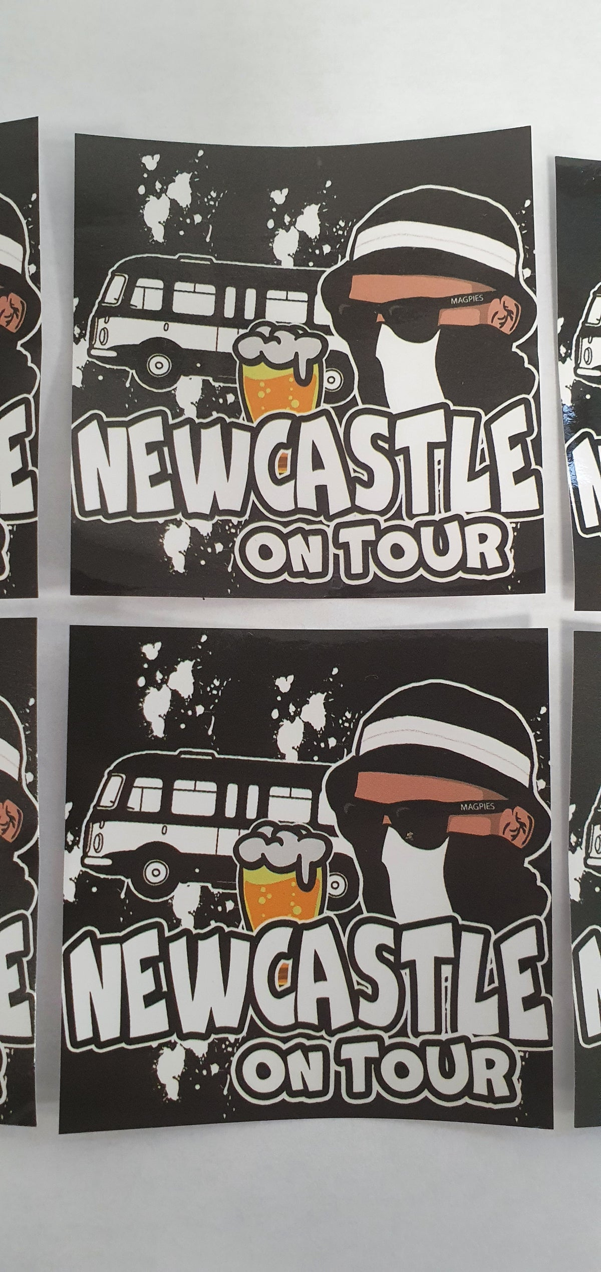 Pack of 25 7x7cm Newcastle on tour football/ultras stickers.