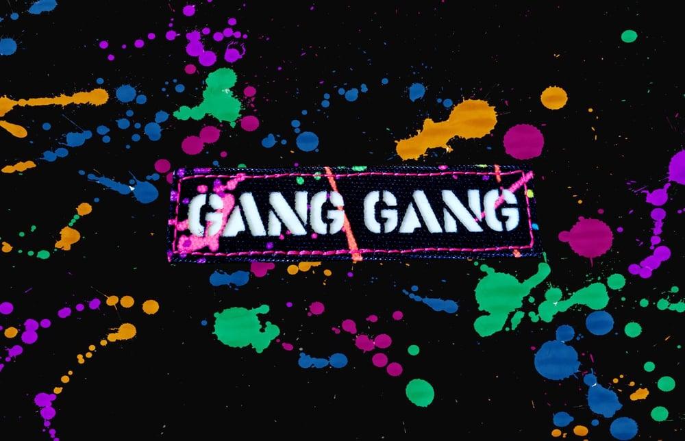 "Image of ""Gang Gang"" splatter paint laser cut glow-in-the-dark"