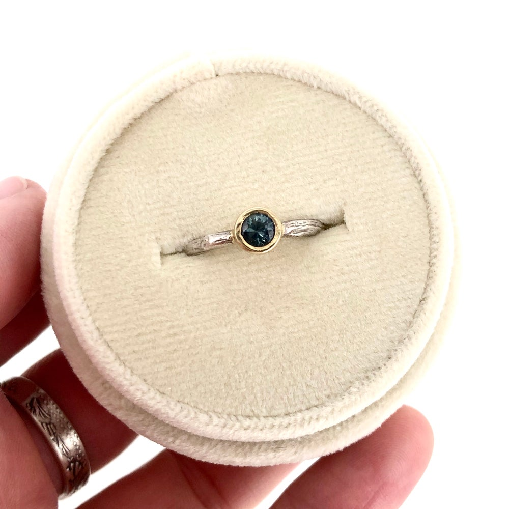 Image of teal Montana sapphire engagement ring . twig band