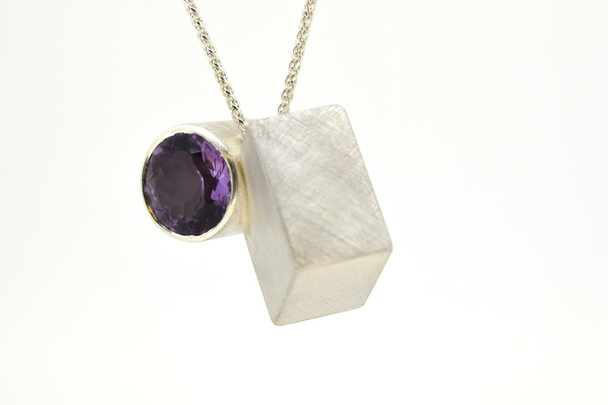 Amethyst intersection forms necklace
