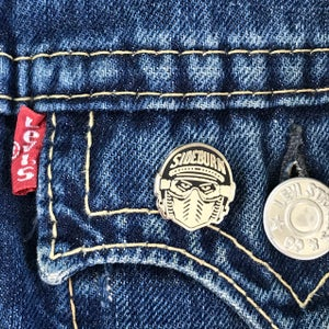 Image of Raceface enamel pin badge