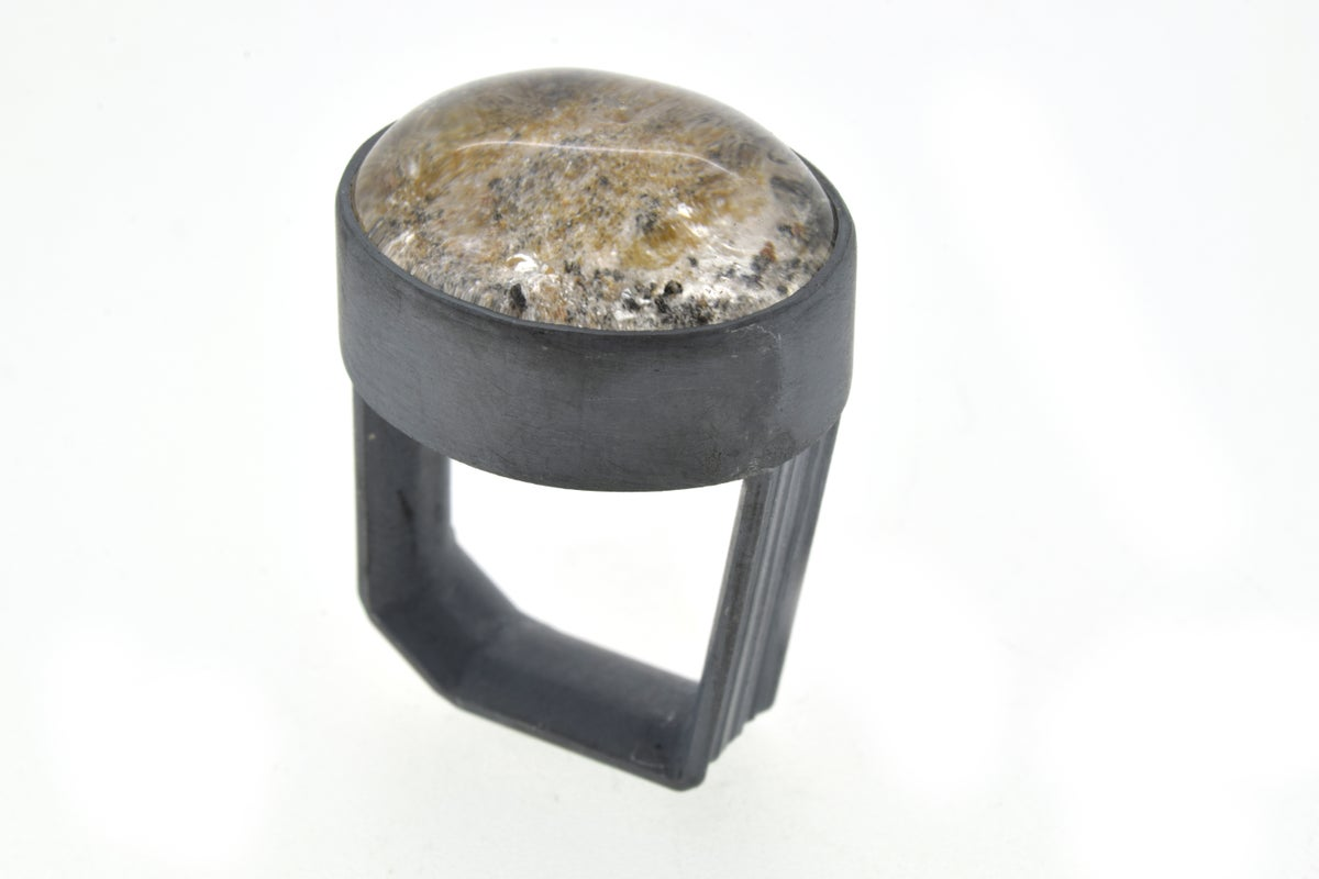A monolith ring in sterling silver with a Quartz with  Lodolite quartz. Chris Boland Jewellery