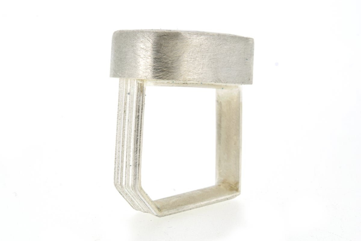 monolith ring in sterling silver with oval Quartz with pyrite inclusions