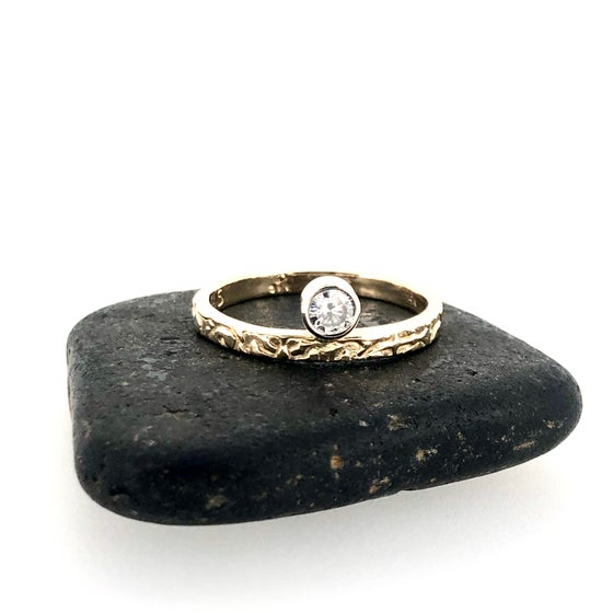 Image of 14k gold rising sun grey moissanite ring
