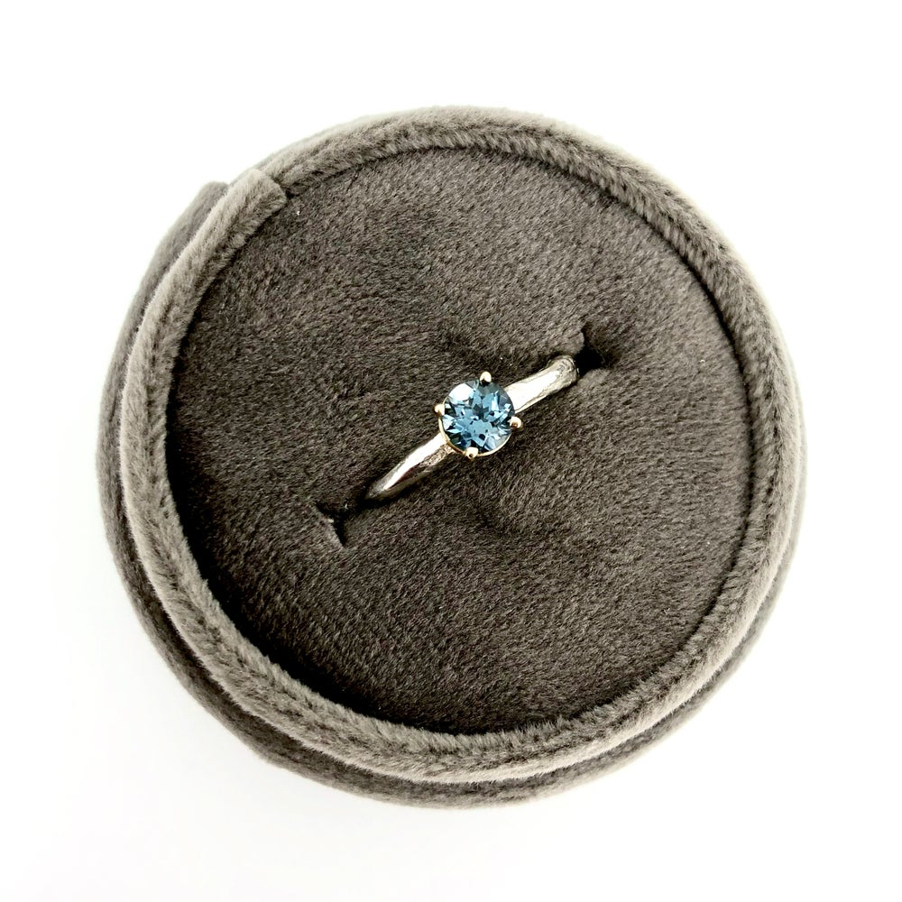 Image of Montana sapphire engagement ring with twig band
