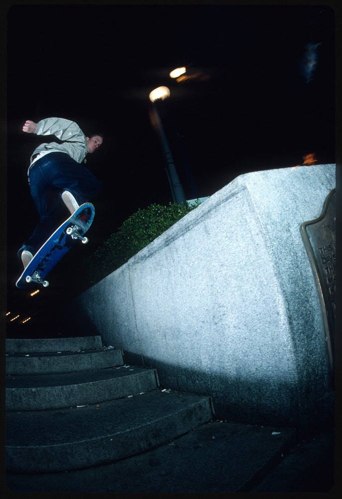 Julien Stranger, Union Square nose slide - San Francisco 1992 by Tobin Yelland