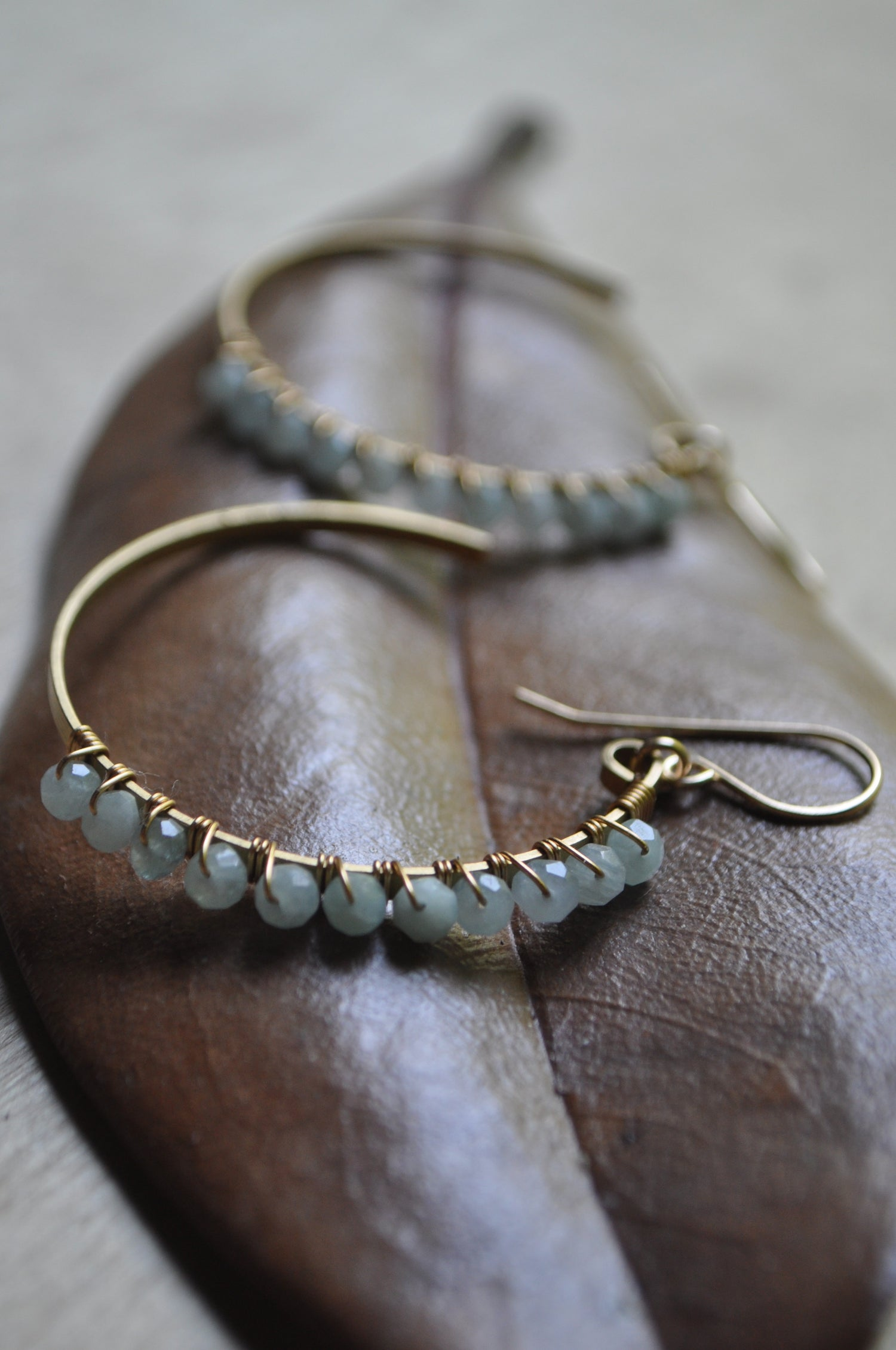 Image of Aquamarine and Brass Crescent Hoops