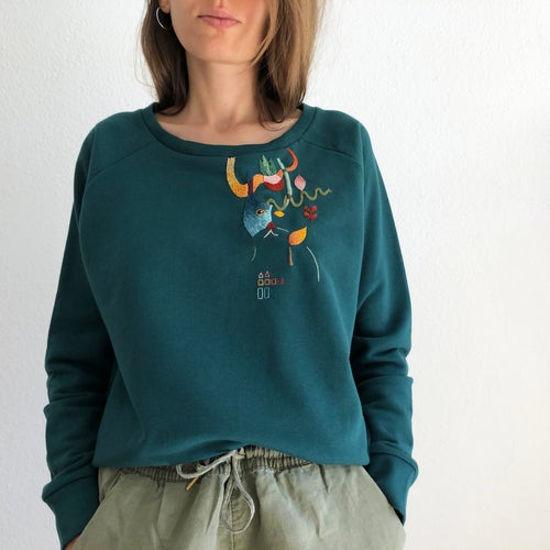 Image of Cat in a bag in a secret garden - original hand embroidery on 100% organic cotton sweatshirt