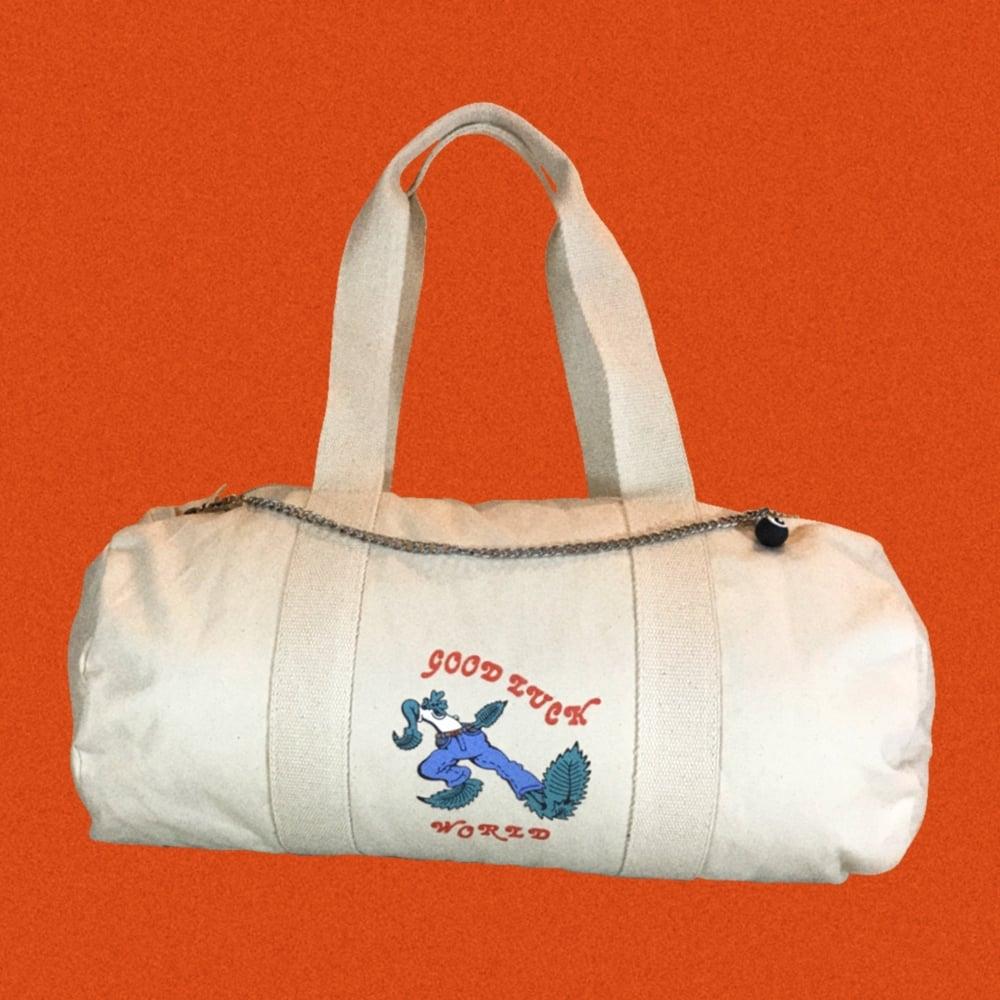 Image of GOOD LUCK WORLD DUFFLE BAG.