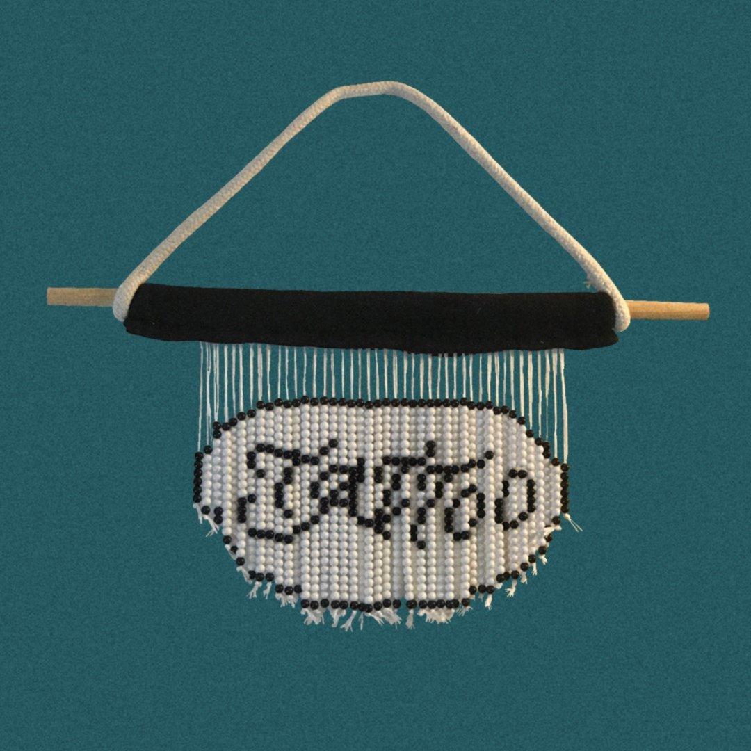 Image of TATTOO BEAD WALL HANGING.