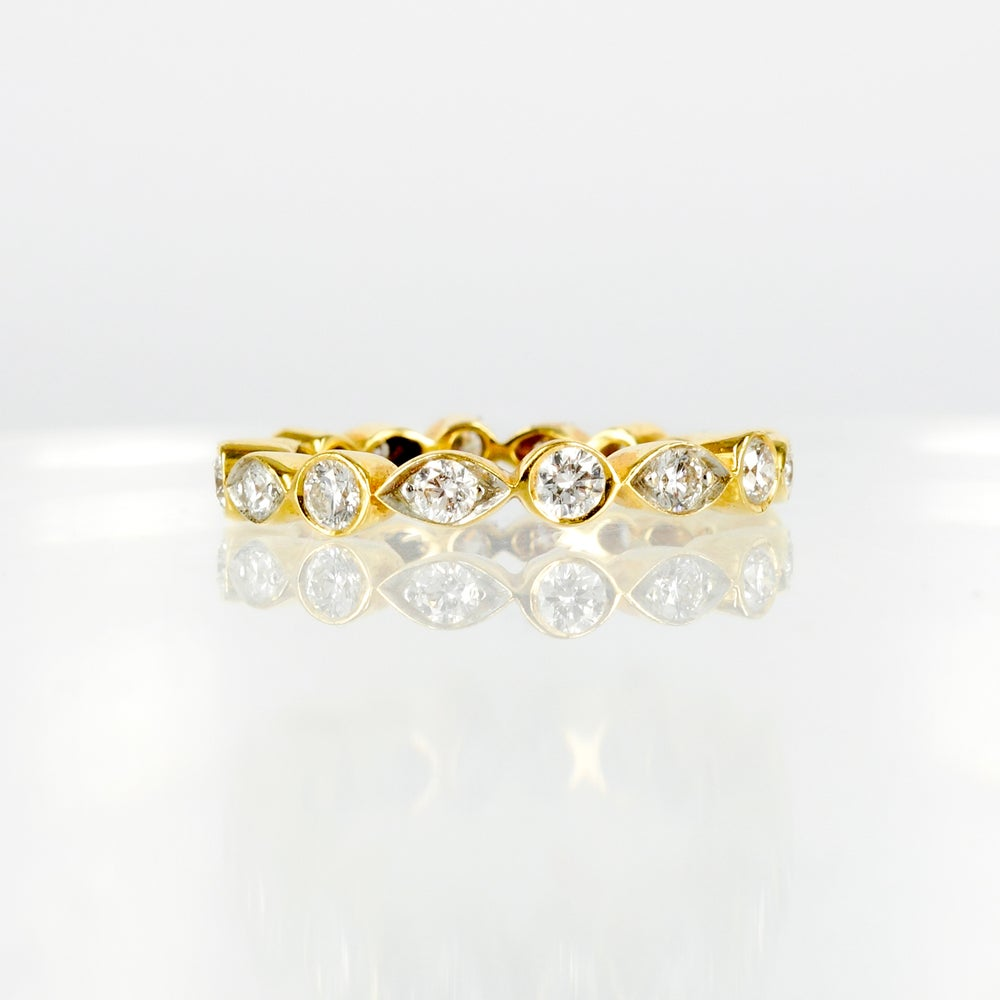 Image of 18ct yellow gold celebration style diamond ring
