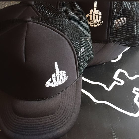 Image of F*cked up trucker hats.