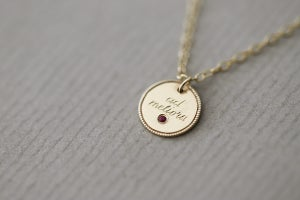 Image of Latin engraved gold disc with Ruby necklace