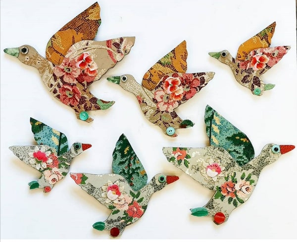 Image of Three Decorated Flying Ducks