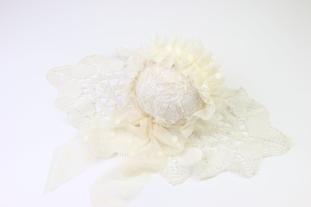Image of Cream Frilled & Dotted Newborn Bonnet