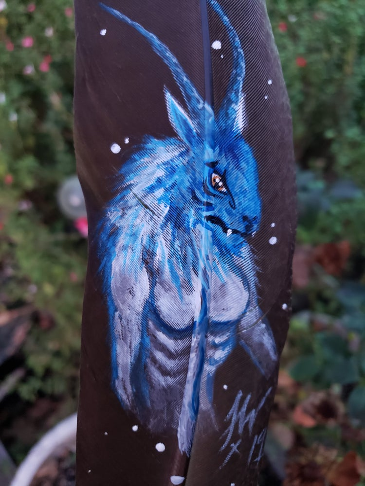 "Image of Yeti on peacock feather ""Grynhildi"""