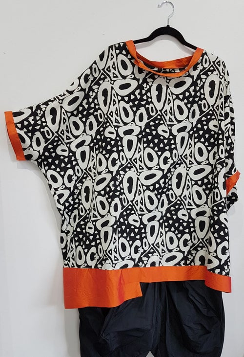 Image of oversized flowy summer top